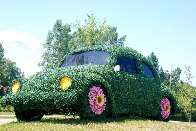 Volkswagen Beetle shrub. A decorative landscaping shrub and flowers in the shape of a Volkswagen Beetle car stock photography