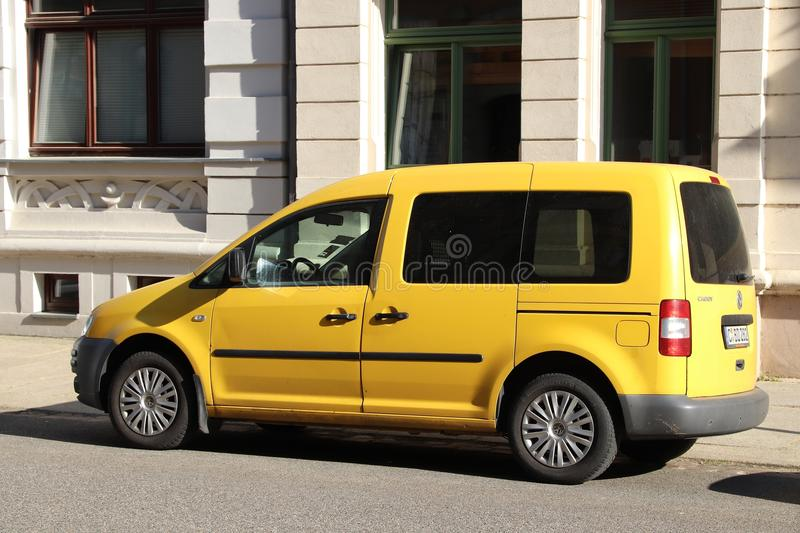 Volkswagen Caddy. CHEMNITZ, GERMANY - MAY 8, 2018: Yellow Volkswagen Caddy small minivan car in Germany. There were 45.8 million cars registered in Germany (as stock images
