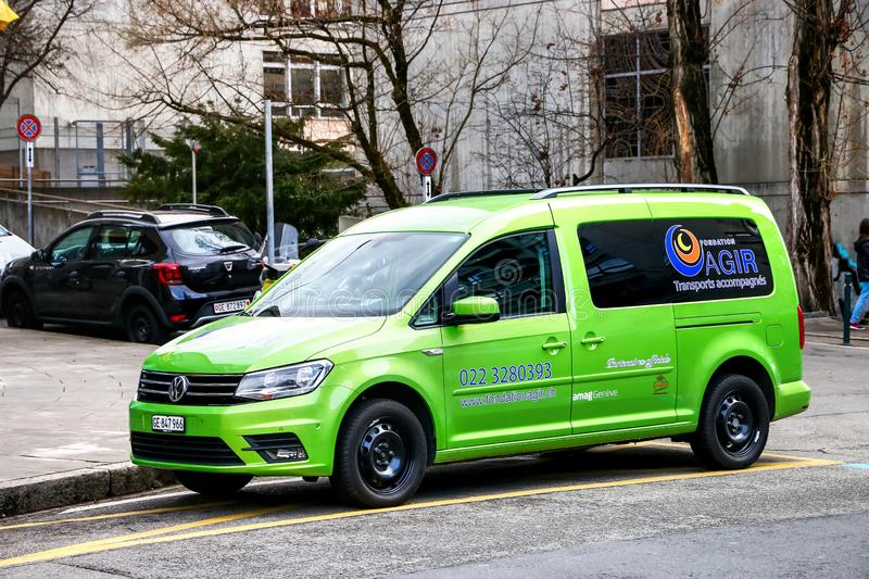 Volkswagen Caddy. Geneva, Switzerland - March 13, 2019: Green leisure activity vehicle Volkswagen Caddy in the city street royalty free stock image