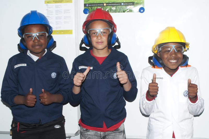 Volkswagen Celebrate family day in uitenhage - Young boys display safety gear royalty free stock image