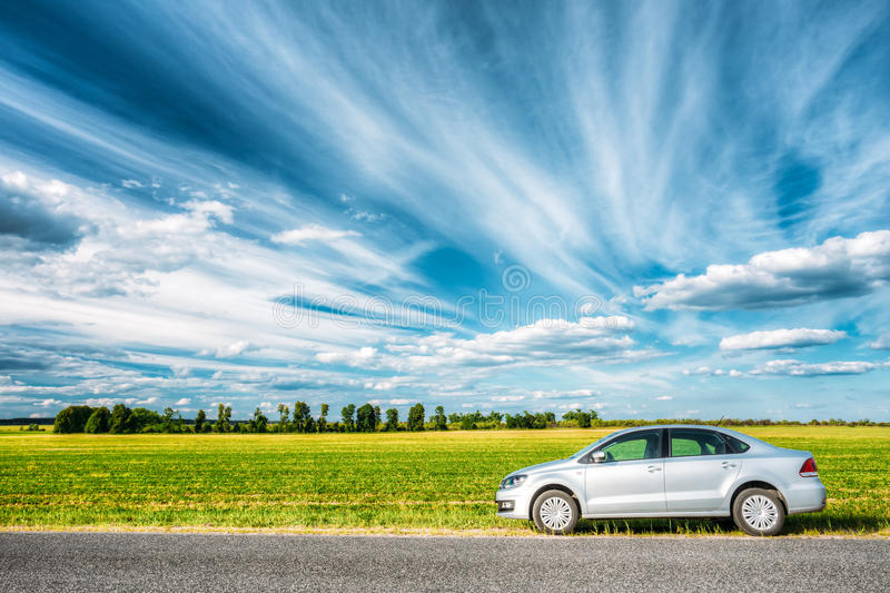 Volkswagen Polo Car Parking On A Roadside Of Country Road On A Background stock photography