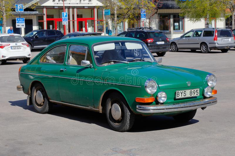 Volkswagen 1600 TE 311. Rattvik, Sweden - May 14, 2019: Front and side view of a green 1972 model Volkswagen 1600 TE 311, Type 3 Fastback Sedan parked at the royalty free stock images