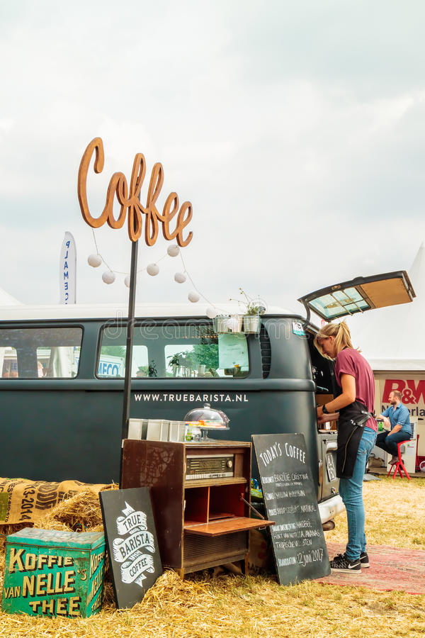 Volkswagen Transporter food and coffee truck on a country fair. AALTEN, THE NETHERLANDS - JUNE 26, 2017: Volkswagen Transporter food and coffee truck on a stock photos