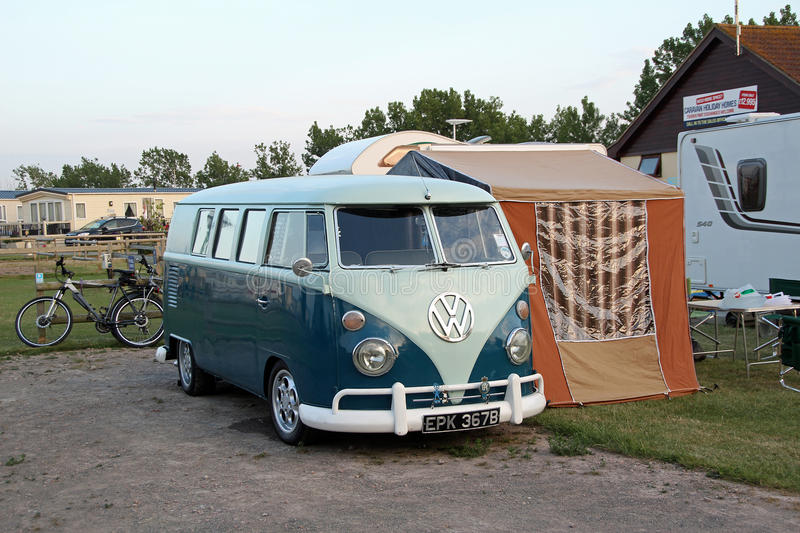 Volkswagon camper van. Photo of a vintage vw split screen camper van with attached awning on campsite whitstable kent. photo taken 19th june 2015 and ideal for royalty free stock photography
