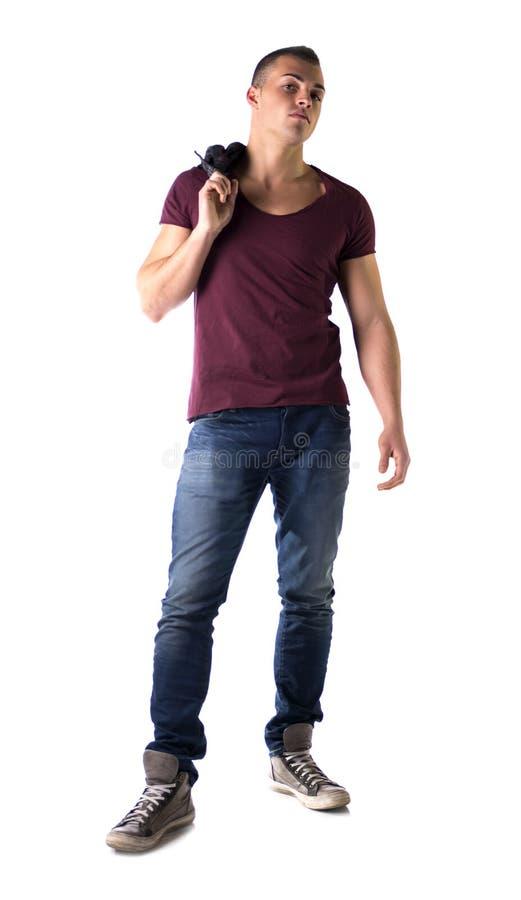 Volledig die lichaam van de knappe jonge mens met t-shirt en jeans wordt geschoten stock fotografie