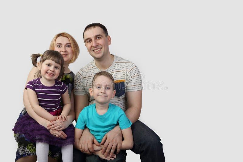 Volledig familieportret stock afbeelding