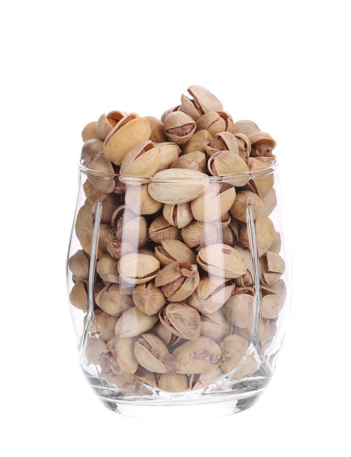 Volledig glas pistaches stock afbeelding