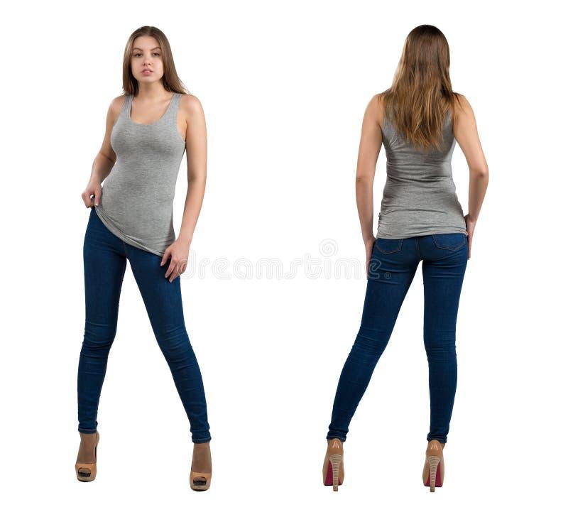 Volledig lengteportret van aantrekkelijk en heet die meisje in vrijetijdskleding, op witte achtergrond wordt geïsoleerd Voor, ach stock fotografie