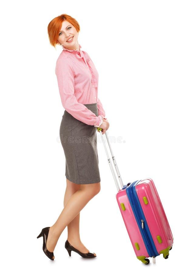 Volledig lengteportret van een Bedrijfsvrouw in zakenreisstandi royalty-vrije stock foto's