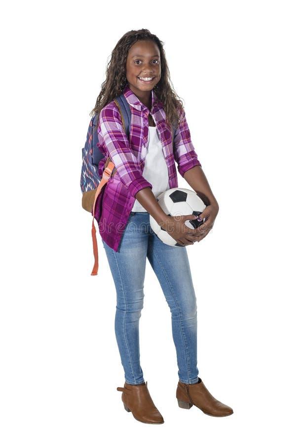 Volledig lengteportret van een glimlachende Afrikaanse Amerikaanse tiener royalty-vrije stock afbeelding