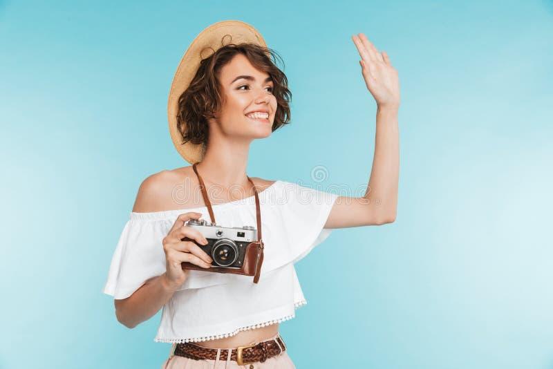 Volledig lengteportret van een glimlachende jonge vrouw royalty-vrije stock fotografie