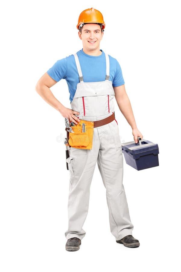 Volledig lengteportret van een handarbeider die een hulpmiddeldoos houden stock afbeeldingen