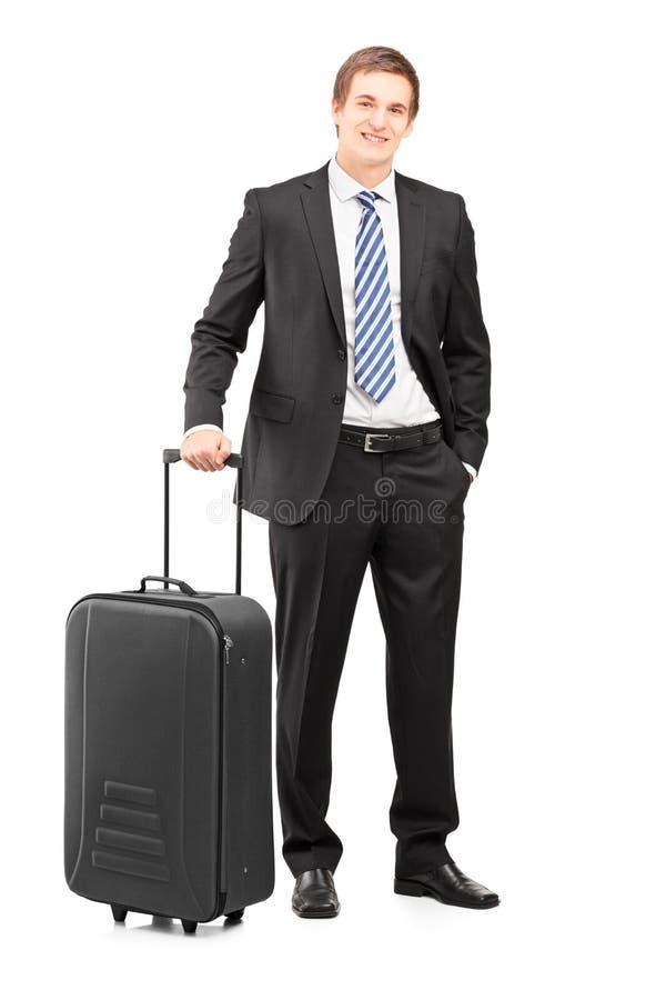 Volledig lengteportret van een jonge zakenman met een koffer royalty-vrije stock afbeeldingen