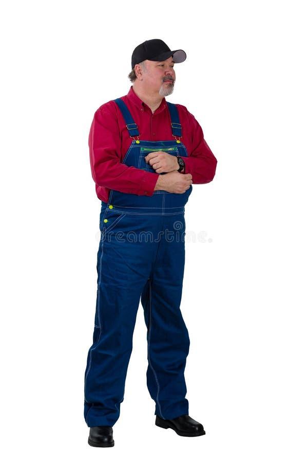 Volledig lengteportret van een landbouwer of een arbeider royalty-vrije stock afbeelding