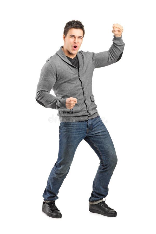 Volledig lengteportret van een mannelijk gesturing geluk stock foto