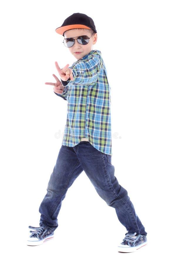 Volledig lengteportret van het glimlachen van weinig jongen in jeanskop stock foto