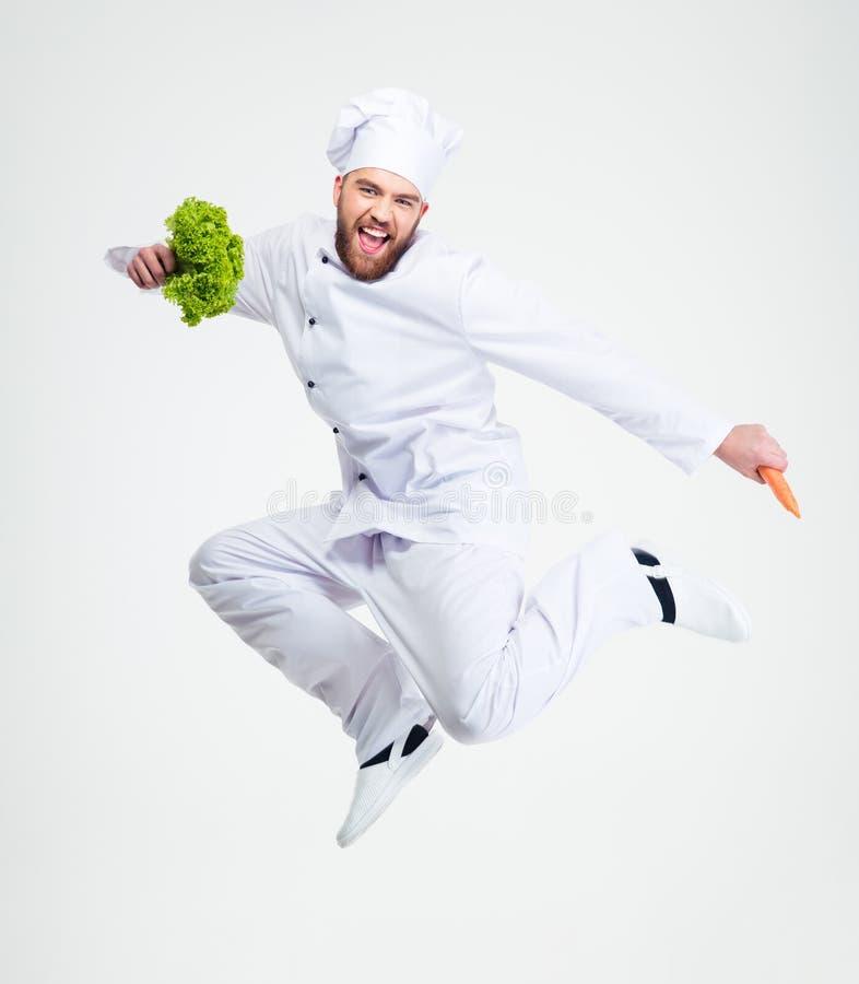 Volledig lengteportret van het vrolijke chef-kokkok dansen stock foto