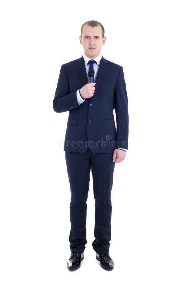 Volledig lengteportret van jonge mannelijke verslaggever met microfoonisol royalty-vrije stock foto