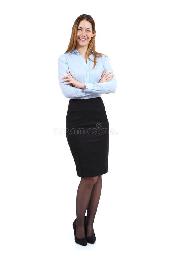 Volledig lichaamsportret van een jonge gelukkige bevindende mooie bedrijfsvrouw stock afbeeldingen