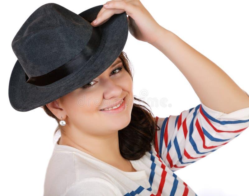 Volledig meisje met hoed het glimlachen stock fotografie