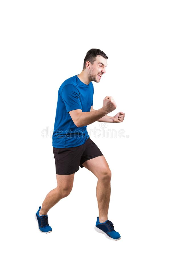 Volledig opgeheven lengteportret van jonge mensenatleet met handen, het vieren overwinning De sportieve kerel die sportkleding dr royalty-vrije stock afbeelding