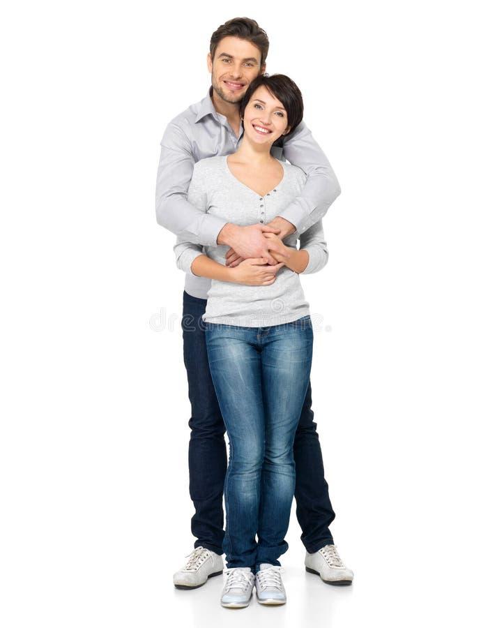 Volledig portret van gelukkig die paar op wit wordt geïsoleerd royalty-vrije stock fotografie