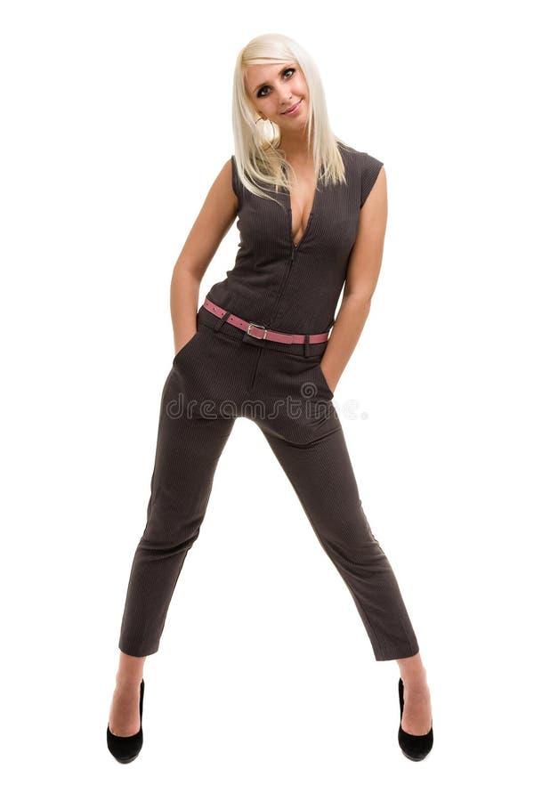 Volledige lengte van een mooie jonge vrouw in algemene status over wit stock foto