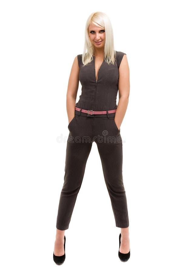 Volledige lengte van een mooie jonge vrouw in algemene status over wit stock afbeelding