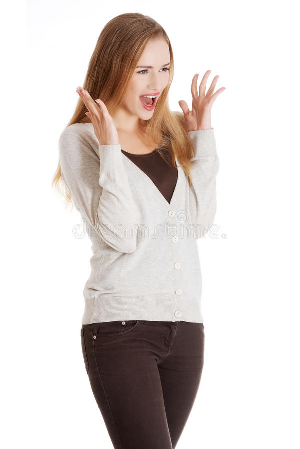Volledige lengte verraste blondevrouw stock afbeelding