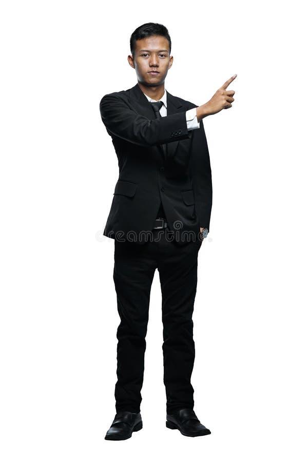 Volledige Lichaams Jonge Aziatische Zakenman Pointing Something Isolated Wh stock afbeeldingen