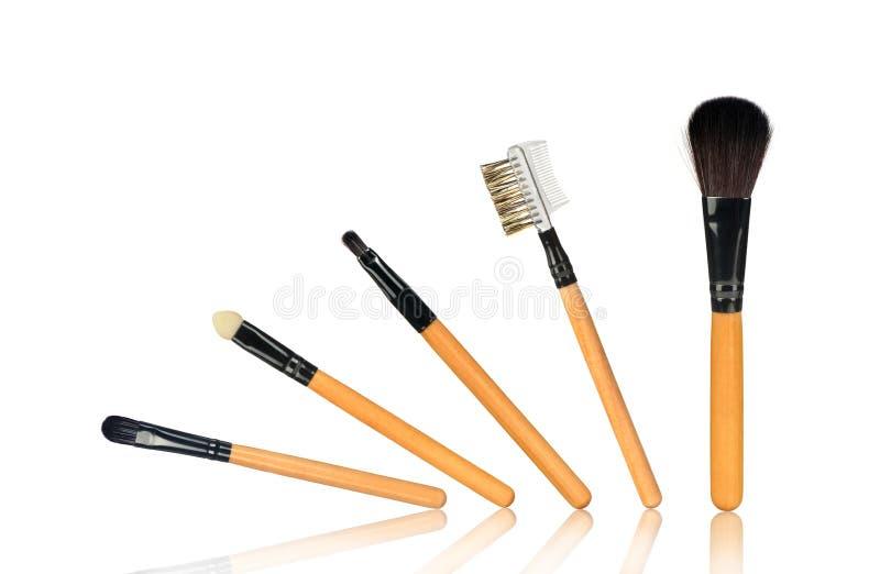 Volledige reeks make-upborstels stock afbeelding