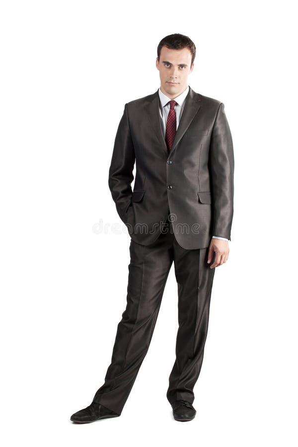 In voller Länge Geschäftsmann mit der Hand in der Tasche lizenzfreie stockfotografie
