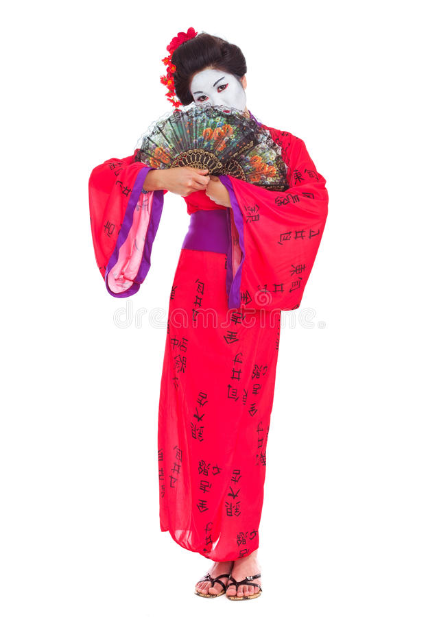 In voller Länge Portrait der Geisha versteckend hinter Gebläsen lizenzfreie stockfotos