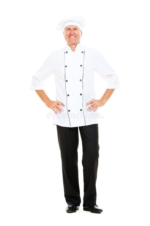 In voller Länge Portrait des glücklichen älteren Kochs stockfotos