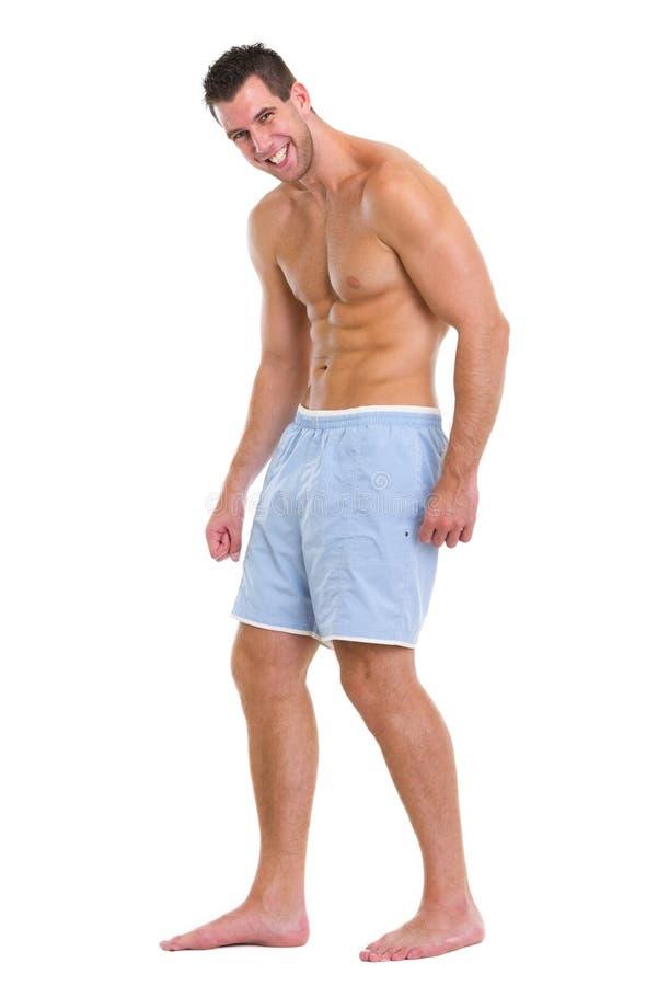 In voller Länge Portrait des muskulösen Sportmannes lizenzfreie stockfotos