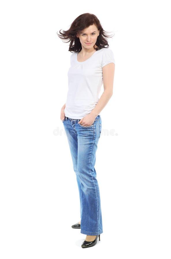 In voller Länge Portrait des schönen Mädchens in den Jeans stockfotografie