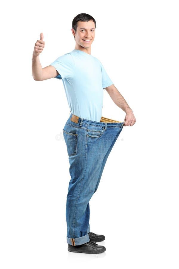 In voller Länge Portrait eines Gewichtverlustmannes stockfoto