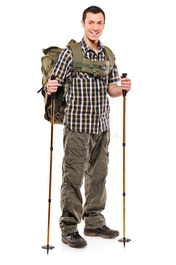 In voller Länge Portrait eines Mannes mit Rucksack lizenzfreies stockbild