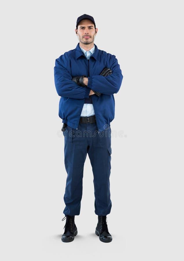 Volles Körperporträt des Sicherheitsbeamtemannes stehend mit grauem Hintergrund stockbilder