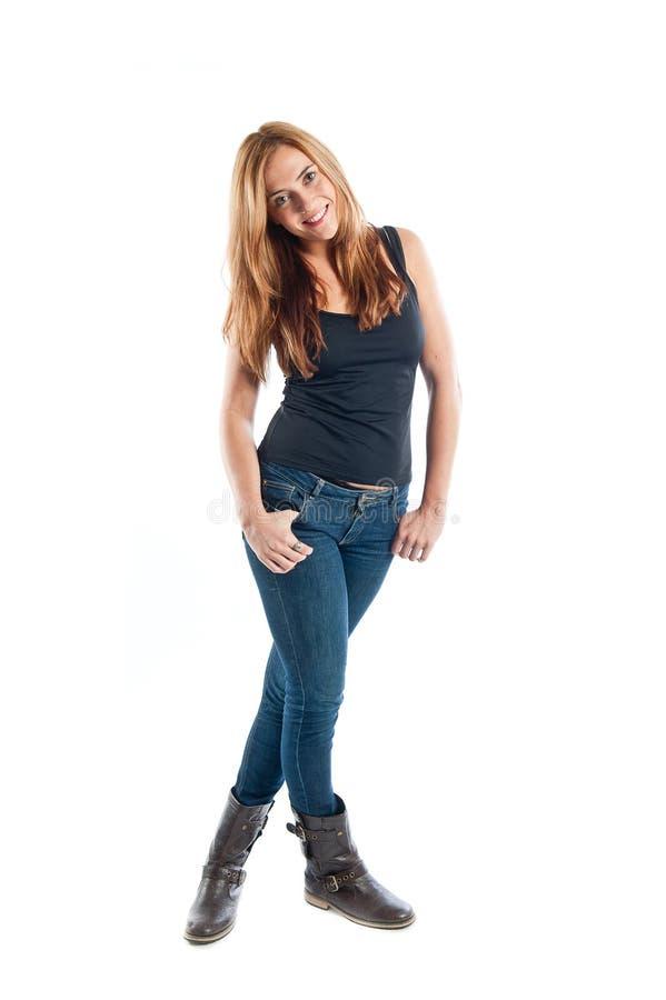 Volles Körperporträt einer glücklichen lächelnden jungen Frau stockfotos