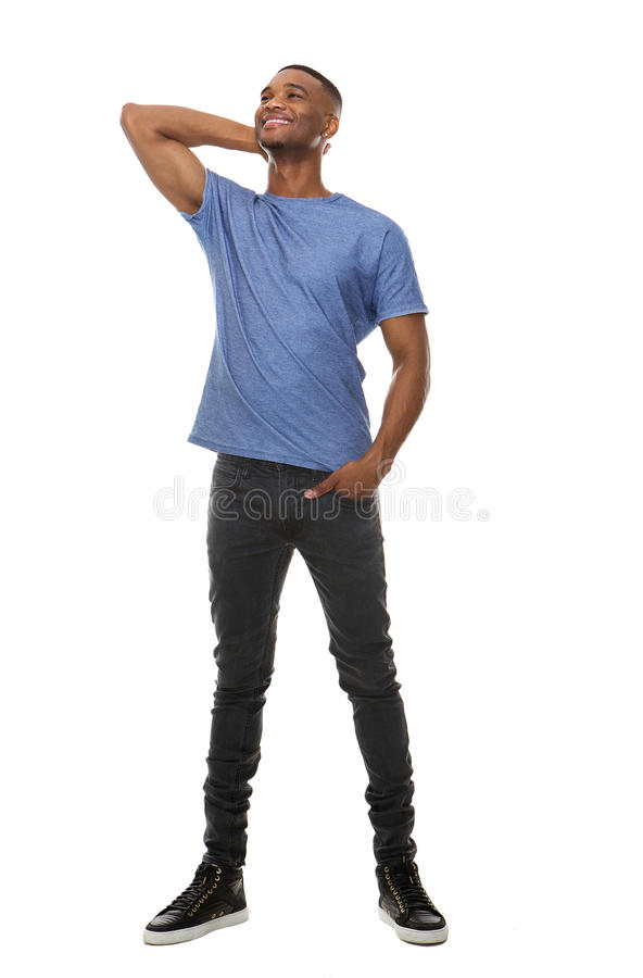 Volles Körperporträt eines kühlen Kerllächelns stockbild