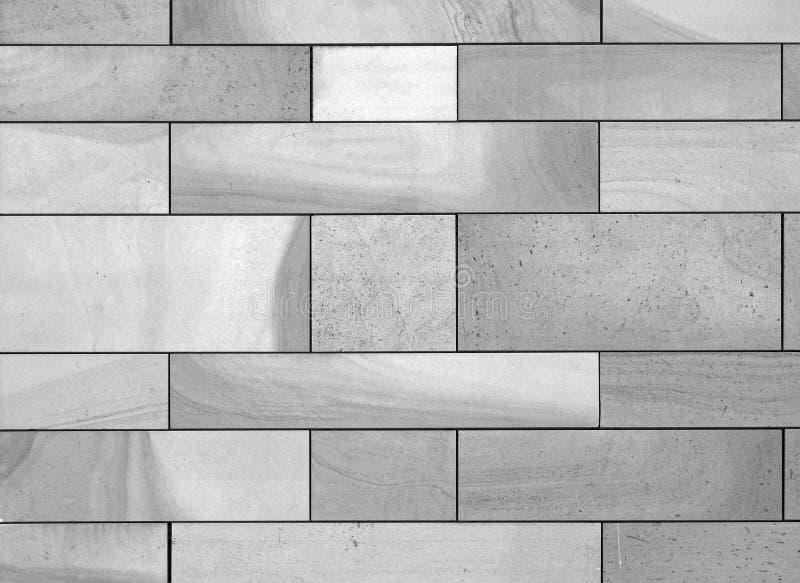 Volles Rahmenbild einer Wand hergestellt von den großen flachen Blöcken des strukturierten grauen Steins lizenzfreie stockfotografie