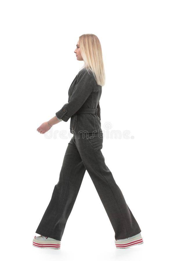 volles Wachstum motivierte Geschäftsfrau, die vorwärts geht stockfotografie