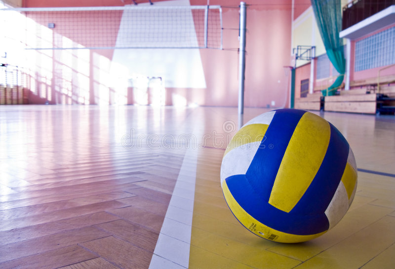 Volleyball in a gym on the floor clouseup stock photos