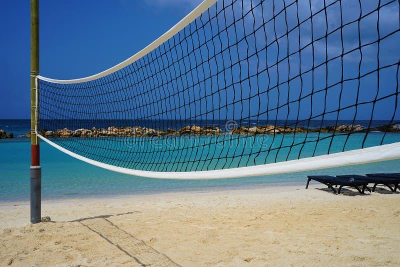 Volleyball net on the Caribbean beach. Hobby, sport, activity, active, group sport, caribbean sea, beach, summer, sky, sand, blue, net, travel, volley ball, sea stock photography
