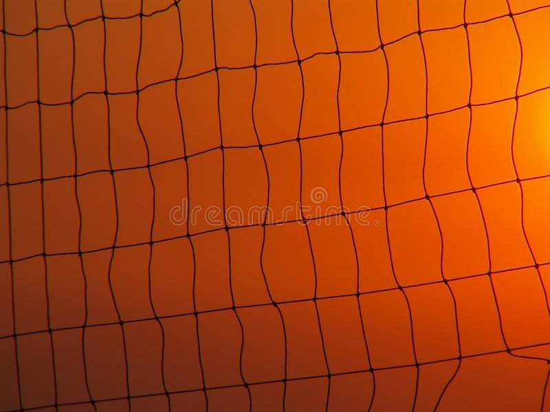 Volleyball net on sunset sky stock photo