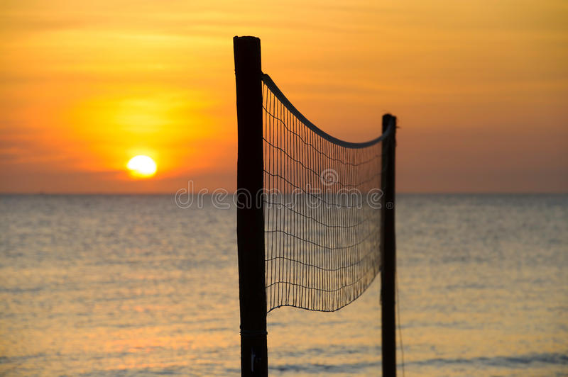 Volleyball net at sunset. A volleyball net at sunset on a tropical beach royalty free stock images