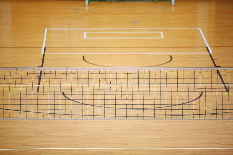 Volleyball play ground. With net in center stock image