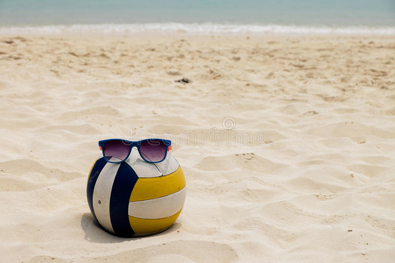 Volleyball at the Summer Beach. A Volleyball at the Summer Beach with a Sunglass royalty free stock images