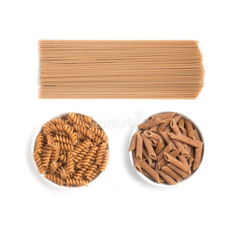 Vollkornteigwaren Spaghettis, Penne und Fusilli stockfotografie